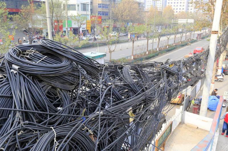 Dense wire and cable wrapped together, adobe rgb. Dense wire and cable in street of xian city, china. xian is an ancient and young city. xian is trying to catch royalty free stock photography