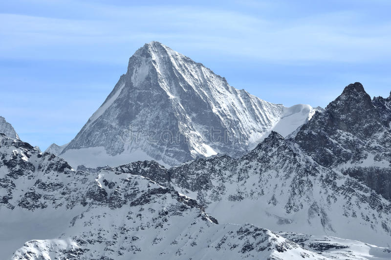 The Dent Blanche. The famous dent blanche (white tooth) in the swiss alps in winter stock image