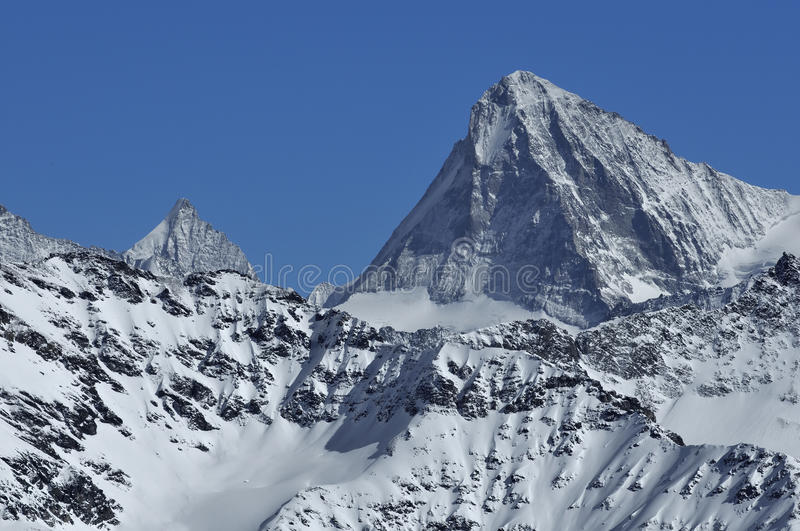 The Dent Blanche. The formidable Dent Blanche (right) with the pointe de Zinal (left) in the Swiss Alps royalty free stock images