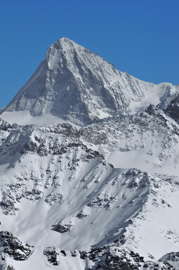 The Dent Blanche. The White Tooth (Dent Blanche) in the swiss alps in the winter stock image