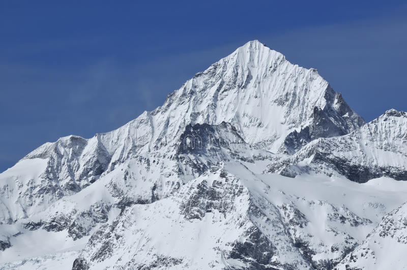 The Dent Blanche. The east face of the Dent Blanche covered in fresh snow in the southern swiss alps above Zermatt royalty free stock photography