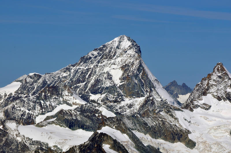 The Dent Blanche. Flanked by the Grand Cornier in the Swiss Alps above Zermatt in the summer stock photo