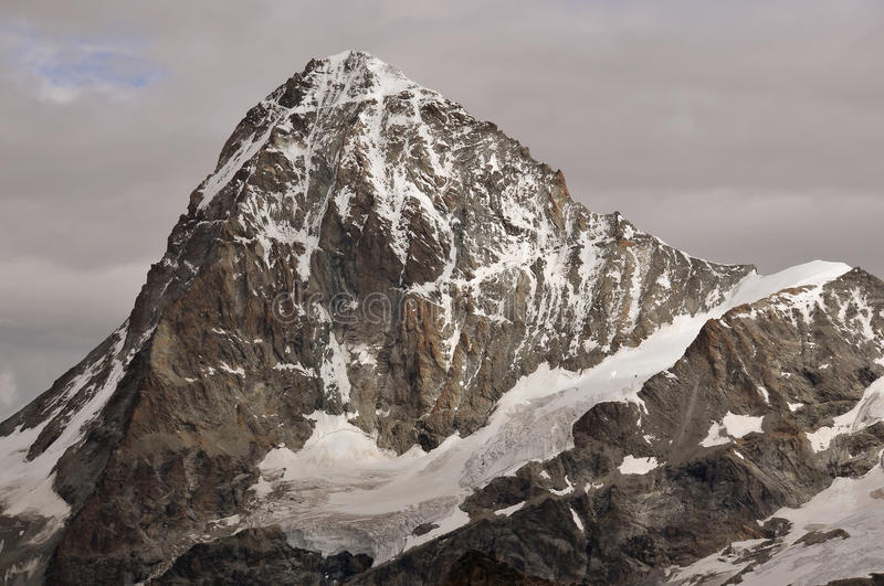 Dent Blanche. The summit of the famous Dent Blanche in the southern swiss between Zermatt and Evolene. Viewed from the Bertole cabin royalty free stock images