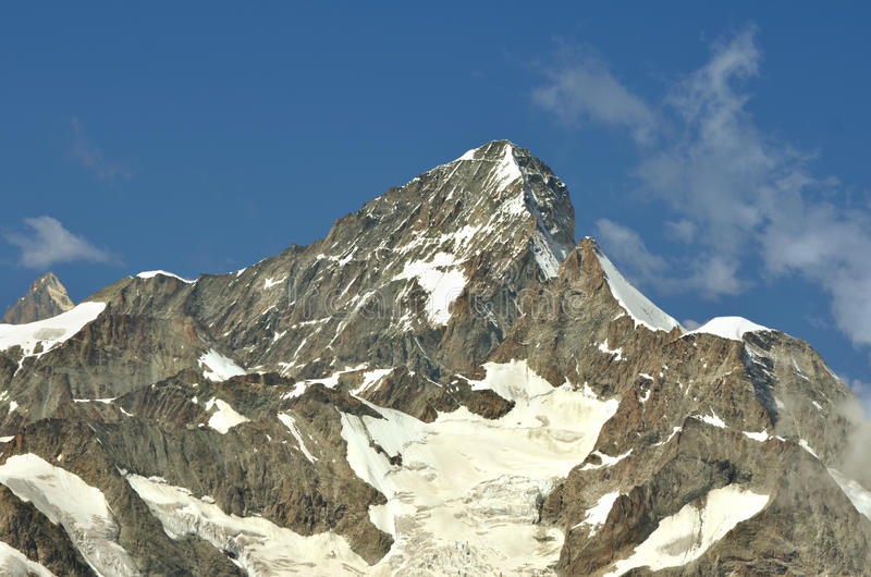 The Dent Blanche. Of the alpine giants in the southern swiss alps between Zermatt and Evolene. In the foreground the obergabelhorn stock image