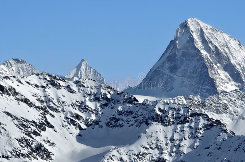The Dent Blanche and the pointe de Zinal stock photos