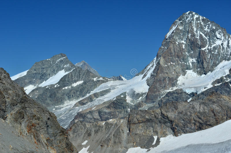 Dent Blanche. The west face of the Dent Blanche (r) with the Grand Cornier (l) in the southern swiss alps near to Zermatt stock photos