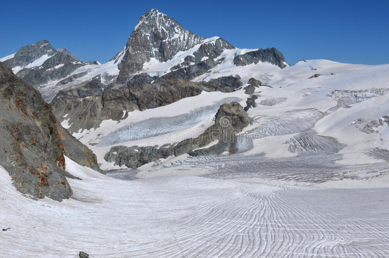 Dent Blanche. The west faces of the Grand Cornier (left) and the Dent Blanche (c) in the southern swiss alps between Zermatt and Zinal, surrounded by extensive stock photos