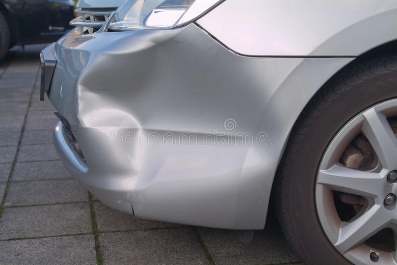 A dent in a car royalty free stock photo