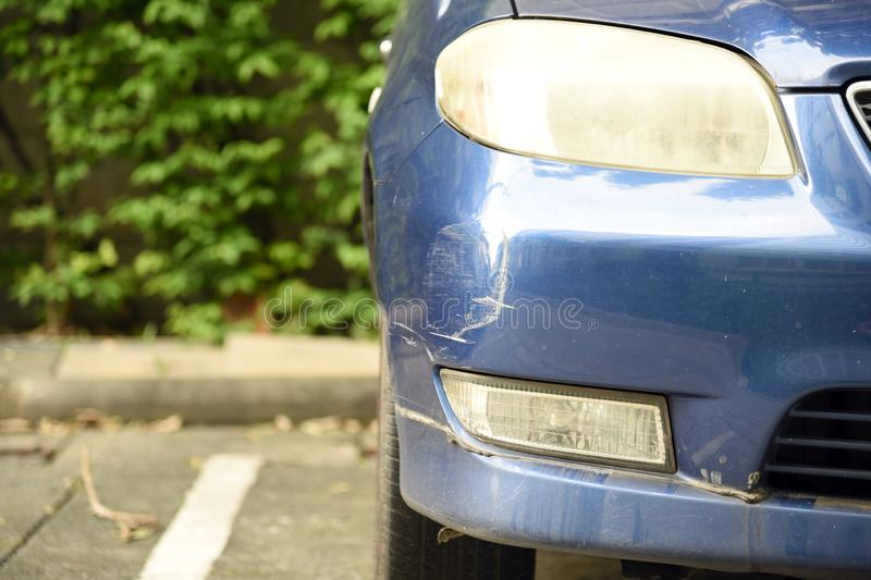 Dent car scratch close-up. Crashed car in accident stock photos