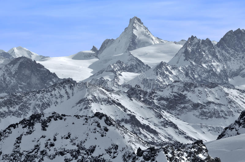 The Dent d'Herens. In the Swiss Alps with Castor (left) and the Tete Blanche stock photo