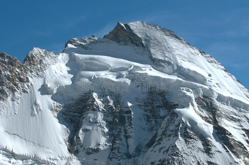 Dent d'Herens. The impressive summit and north face of the Dent d'Herens in the swiss alps above Zermatt stock photography