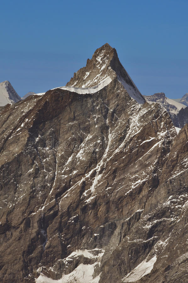Dent d'Herens. The Dent d'Herens viewed from the Italian side, on the Swiss italian border above Zermatt and Evolene royalty free stock photo