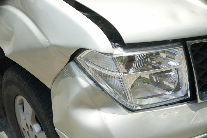 A dent on the right front of a pickup truck (damage from crash). A dent on the right front of a pickup truck (damage from crash accident stock photos
