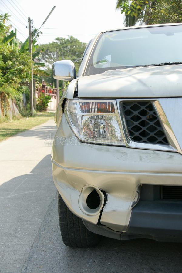 A dent on the right front of a pickup truck. (damage from crashed accident stock photo