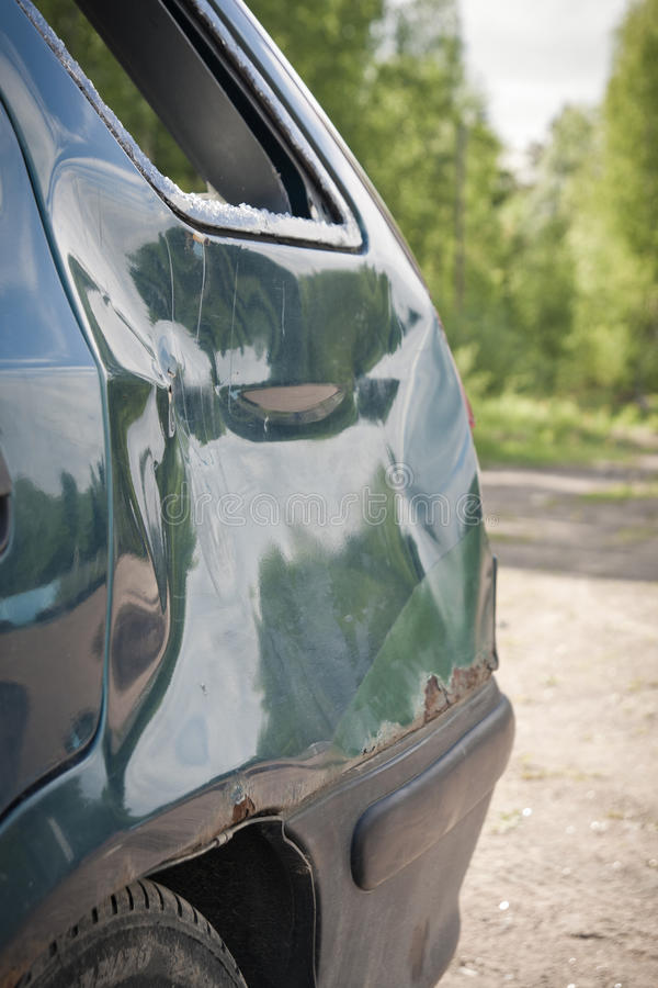 Dent. In Tail of a Damaged Car royalty free stock image