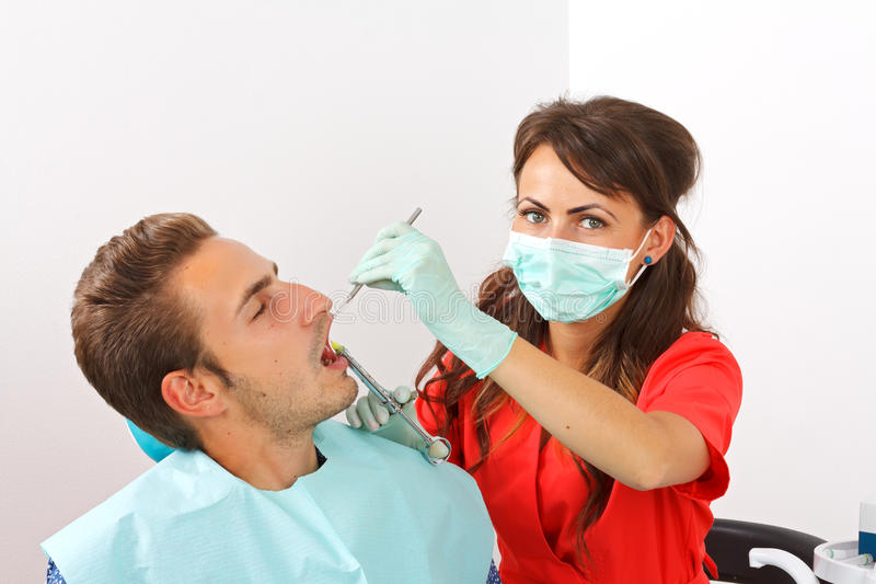 Dental anesthesia. Scared dental patient receiving anesthesia injection stock image