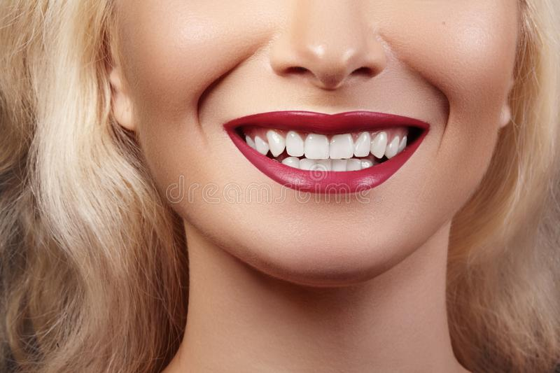 Dental Beauty. Beautiful Macro of perfect White Teeth. Sexy Fashion Lip Red Makeup. Whitening Tooth, Wellness Treatment royalty free stock photos