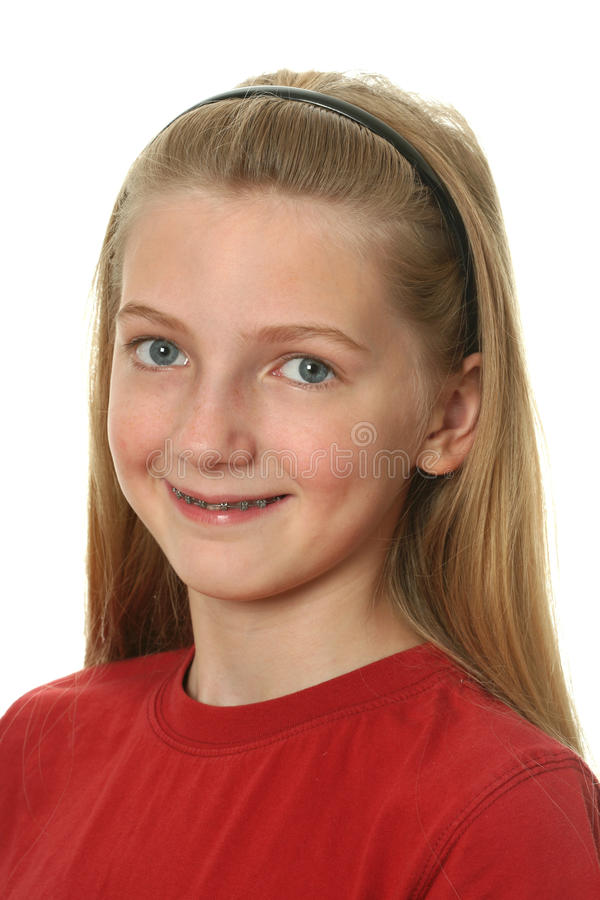 Dental Braces. Young girl with dental braces on her teeth isolated on white stock images