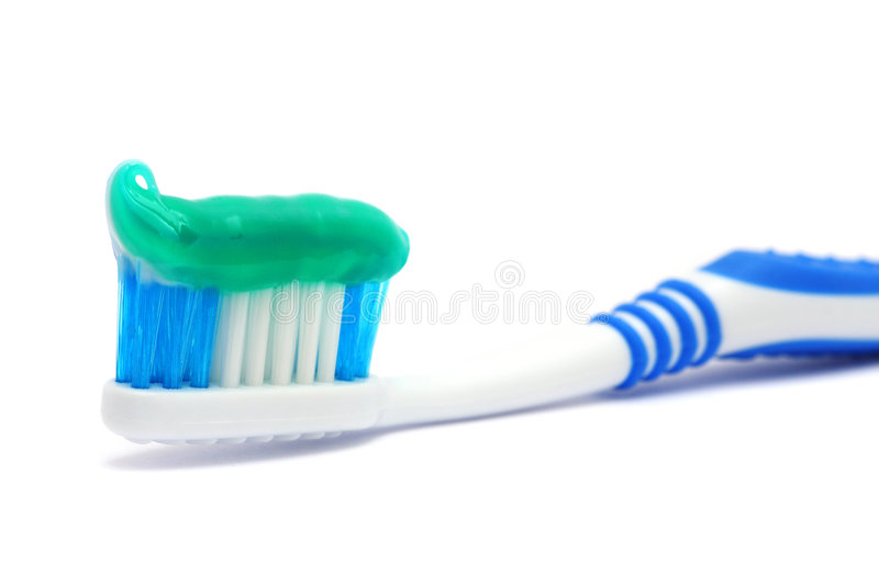 Dental Brush With Toothpaste. Blue dental brush with healthy paste gel on white background stock image