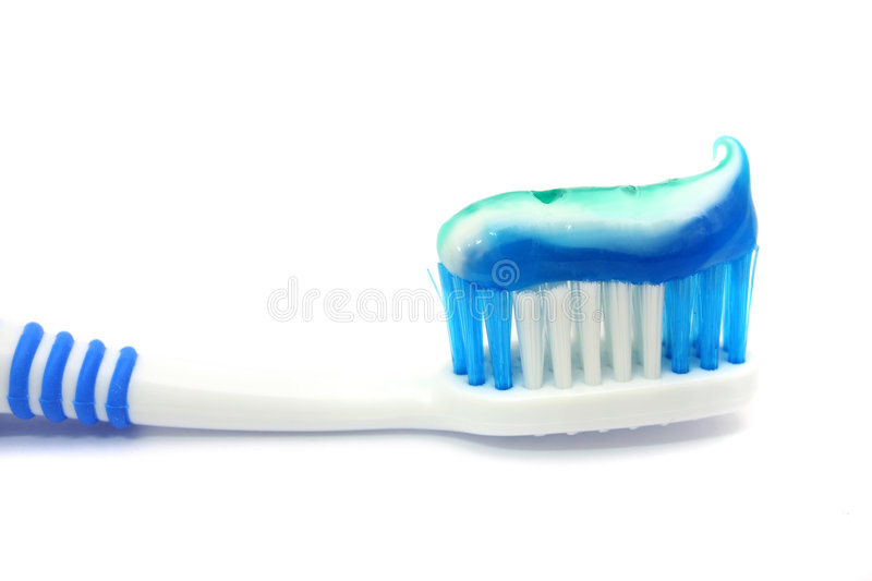 Dental Brush With Toothpaste. Blue dental brush with healthy paste gel on white background royalty free stock photography