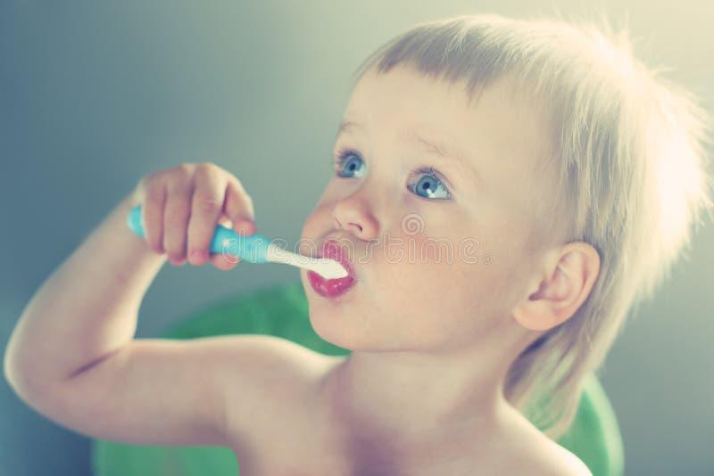 Dental care. Cute toddler boy brushing teeth. Teeth cleaning, dental care