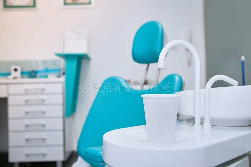 Dental chair in clinic. Dental clinic interior design with chair and tools royalty free stock photography