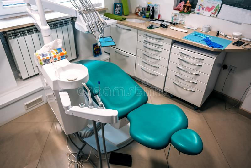 Dental chair and tools. Modern dental practice. Dental chair and other accessories used by dentists in blue, medic light stock image