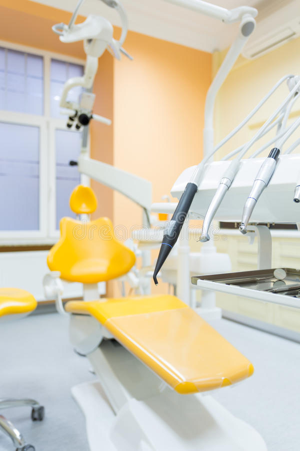 Dental chair. Vertical view of yellow dental chair in stomatologist's office stock photos