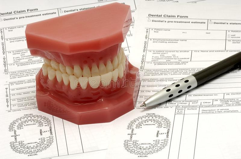 Dental Claim. Forms and Model of Teeth royalty free stock photography