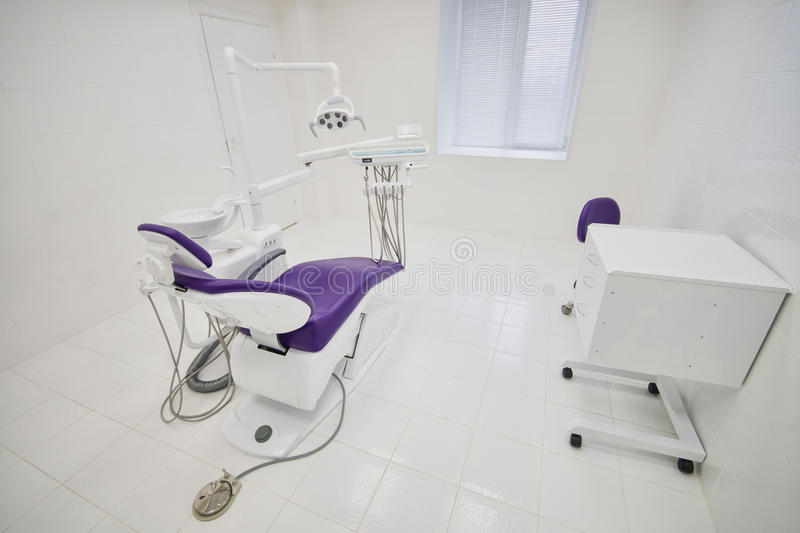 Dental clinic interior with modern dentistry equipment, surgery office royalty free stock images