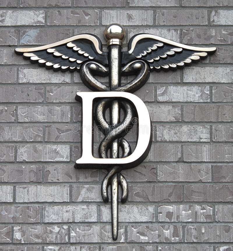 Dental clinic Symbol. Dental Medicine symbol outside de dentist clinic in town royalty free stock image