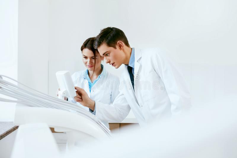 Dental Doctors Working In Dentistry Clinic royalty free stock photography