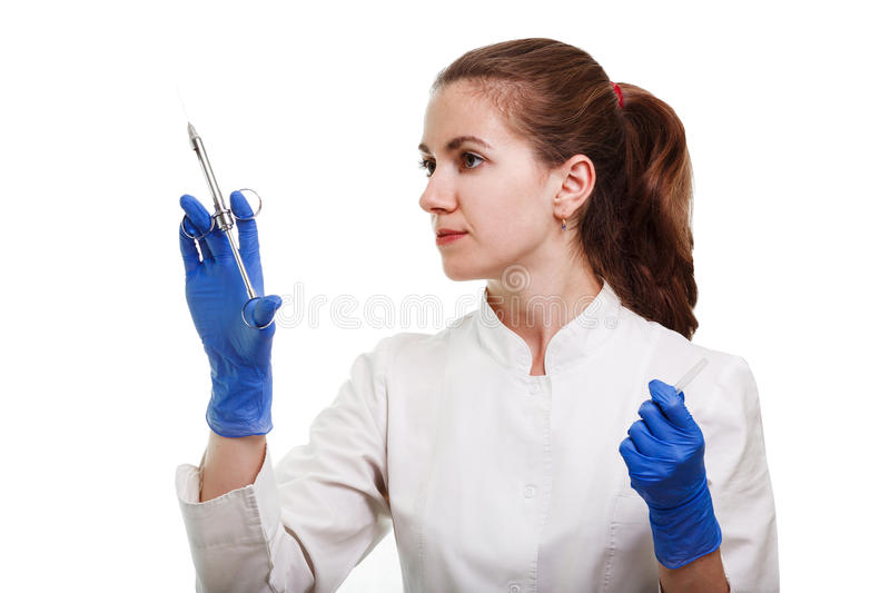 dental and endodontic instruments in hands of dentist. The dentist women in blue gloves holding metal professional tools royalty free stock photos
