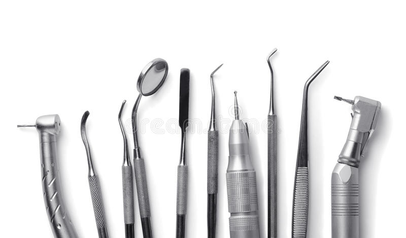 Dental equipment. Row of various dental tools on white stock photography