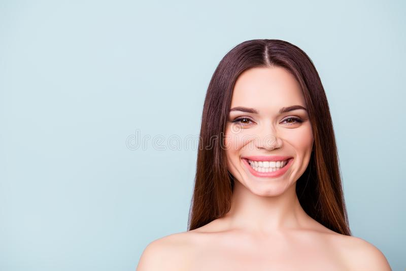 Dental and health concept. Close up portrait of young brunette l. Ady with toothy beaming smile, standing near the copy space stock image