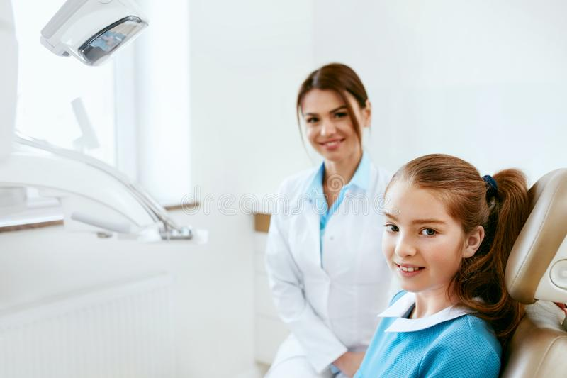 Dental Health. Dentist And Happy Girl In Dentistry Office stock photo