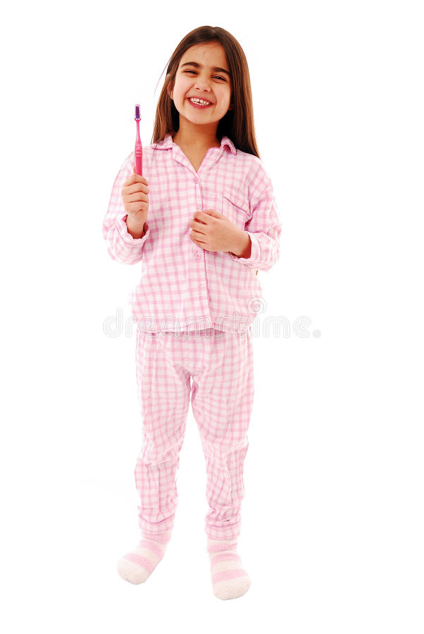 Dental hygiene. Cute girl holding tooth brush isolated over white royalty free stock photo