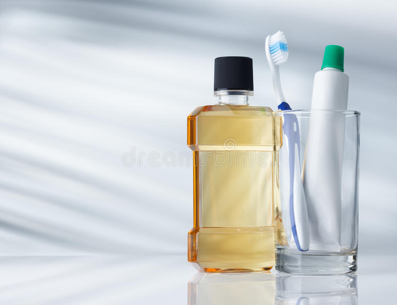 Dental hygiene products. On grey background with copy space stock images