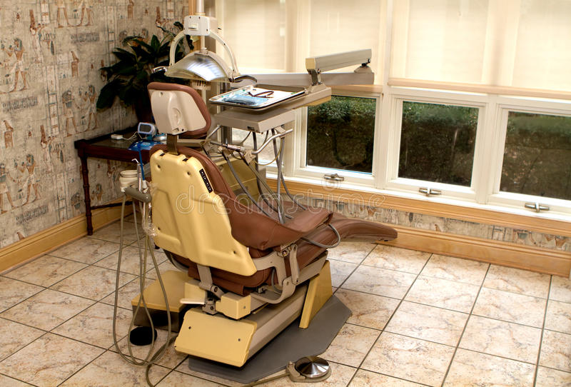 Dental Hygienist Chair. In a dentist office ready for the patient stock images