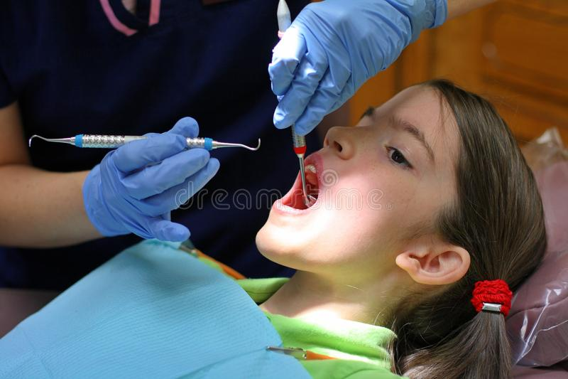 Dental Hygienist At Work. Perfect image of a dental hygienist at work royalty free stock photo