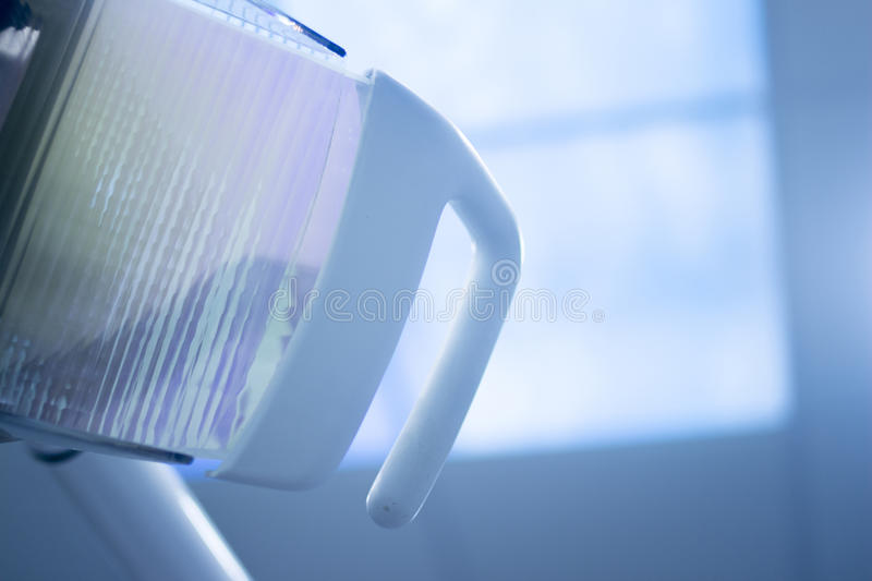 Dental instrumentation dentist equipment chair light. Dental instrumenation dentist equipment chair light in denstists surgery clinic used to light treatments royalty free stock image