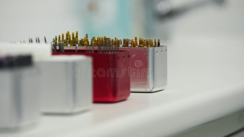 Dental instruments in dental cabinet. Close Up of endodontic instruments royalty free stock images