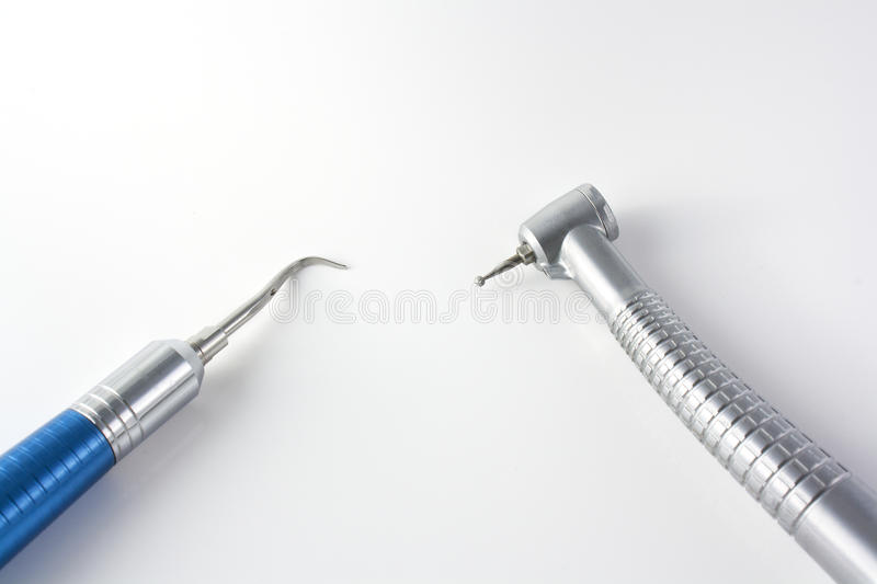 Dental instruments over white background stock photos