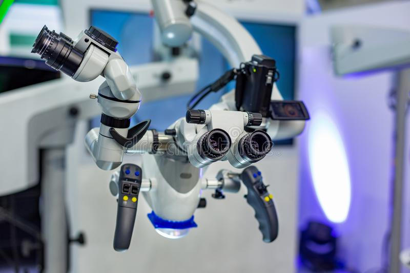 Dental microscope on the background of modern dentistry. Medical equipment. Dental operating microscope with rotary. Dental microscope on the background of stock photography