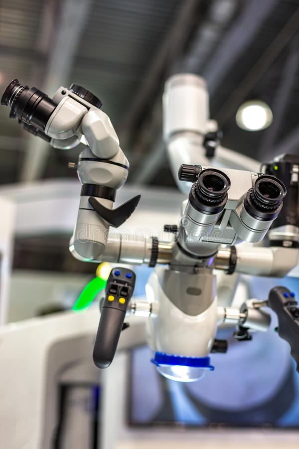 Dental microscope on the background of modern dentistry. Medical equipment. Dental operating microscope with rotary. Dental microscope on the background of royalty free stock photos