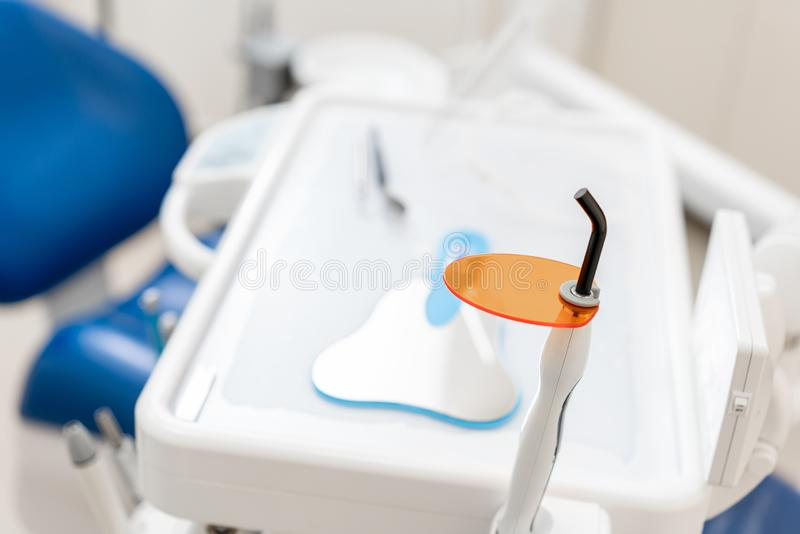 Dental polymerization lamp with UV light and laser. Stomatological instrument in the dentist clinic. Medicine, health. Dental polymerization lamp in dentist hand stock photos