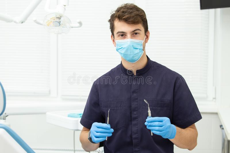 Dental polymerization lamp with UV light and laser. Stomatological instrument in the dentist clinic. Medicine, health. Dental polymerization lamp in dentist hand royalty free stock photo