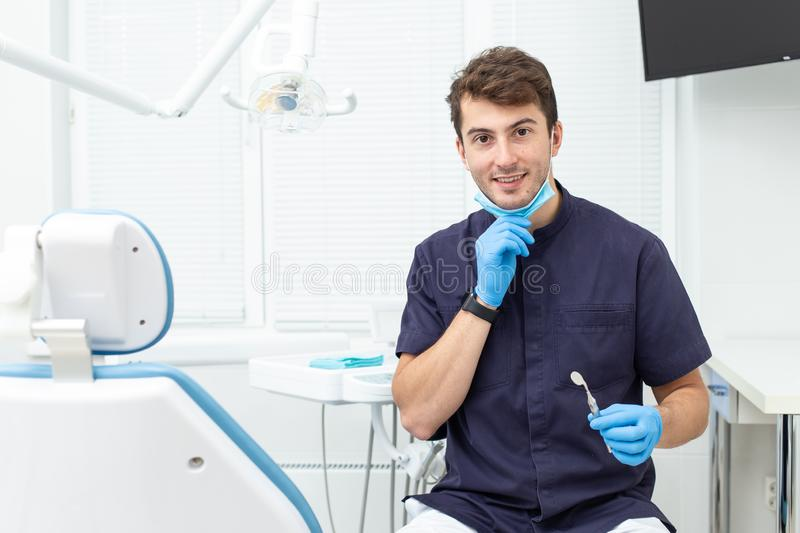 Dental polymerization lamp with UV light and laser. Stomatological instrument in the dentist clinic. Medicine, health. Dental polymerization lamp in dentist hand royalty free stock image