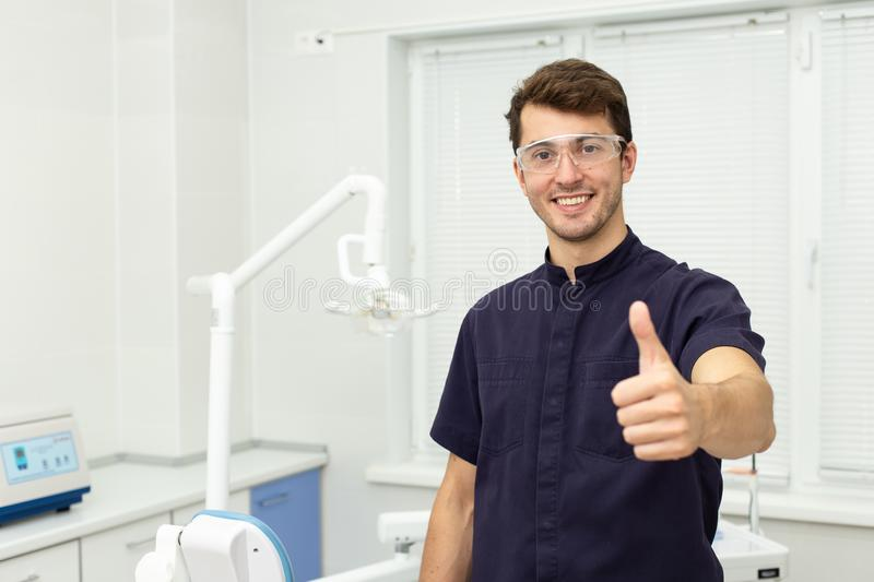 Dental polymerization lamp with UV light and laser. Stomatological instrument in the dentist clinic. Medicine, health. Dental polymerization lamp in dentist hand stock photography
