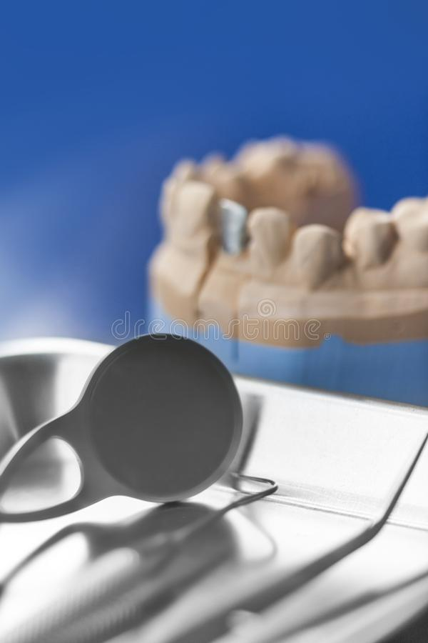 Dental prosthesis with tools stock image